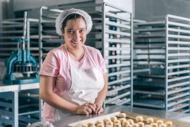 Volunteer with intelectual disability working at a Bakery Workshop, source: gettyimages: https://togoforth.files.wordpress.com/2018/09/gettyimages-594475880_super.jpg?w=391&h=261